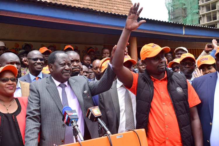 ODM leader Raila Odinga with the party's candidate in the Kibra by-election Imran Okoth at Orange House on September 10, 2019.