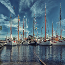 Rescue boats by Jørgen Schei - Transportation Boats ( clouds, fredrikstad, wooden boats, harbour, boats, rescue, isegran, river )