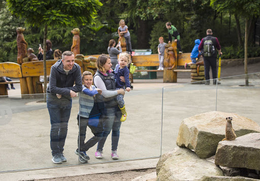 Family enjoying a day out at Edinburgh Zoo in Scotland.