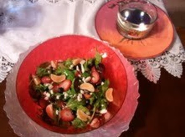 Toss salad.  Garnish top with remaining strawberries, grapes and clementine segments.