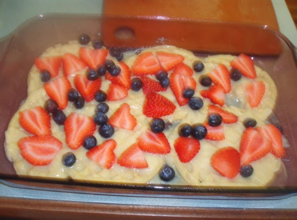 Mix 1/2 of the strawberries with 1/2 blueberries and layer on top of cream.