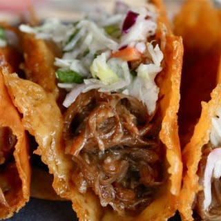 Crispy Cheese Pulled Pork Tacos with Sesame Slaw.