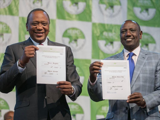 President Uhuru Kenyatta and DP William Ruto with their certificates after IEBC declared them winners of the presidential election on Monday, October 30, 2017