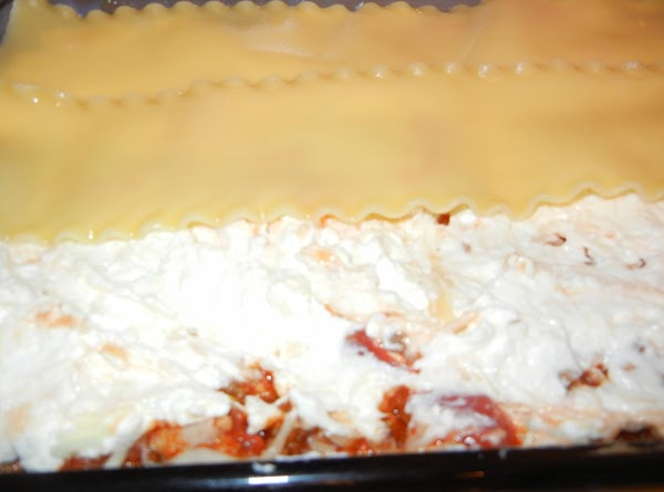 In ungreased baking pan,m 13x9x2 inches, alternate layers of 1/3 each noodles, remaining meat...