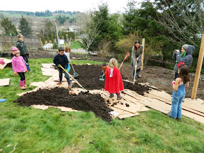 Photo: more help from the kids on the food forest