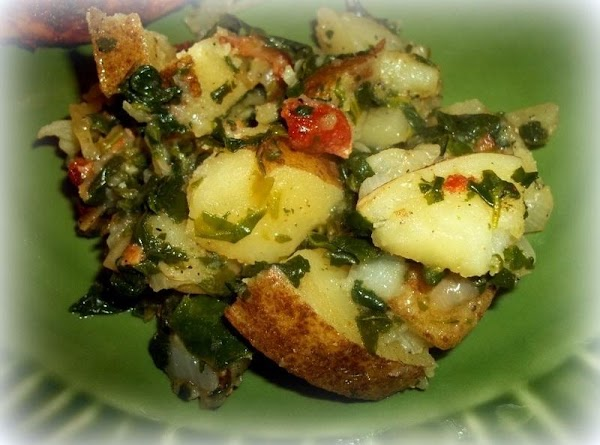 When potatoes are fork tender; sprinkle with the crumbled bacon and serve.