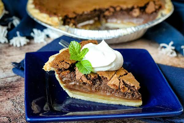 Slice Of Chocolate Buttermilk Pie With Whipped Cream.