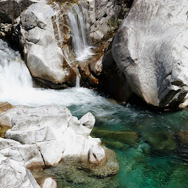 Lavertezzo, Ticino, Switzerland by Serguei Ouklonski - Nature Up Close Rock & Stone ( rock - object, long exposure, summer, rock, waterfall, flowing water, day, sky, no person, fair weather, solid, motion, nature, switzerland, wet, beauty in nature, water, power in nature, flowing, stone, environment, rock formation, ticino, outdoors, river, travel, scenics - nature, no people, non-urban scene, landscape, nature landscape )