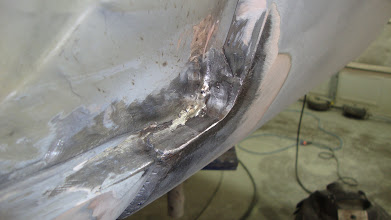 Photo: Nicely welded closed with new metal to attach the new quarter panel.