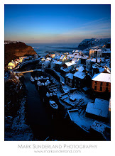 Photo: Staithes  I thought it was time to post something seasonal, so here's an image of Staithes taken a few years back with my Deardorff camera. I drove to Staithes across the moor from York, where there was no snow that day, so was pleasantly surprised to find this viewpoint with snow on the rooftops. I waited all afternoon for this light to appear, and was almost frozen to the spot, when a very nice lady in the house near the outlook popped out with a hot cup of tea to warm me up! It's a great subject at this time of year, as the sun sets more-or-less to the South-West and so the last rays of light shine down the river valley and catch the rooftops nicely.  Deardorff 45 Special, Schneider Super Angulon 90mm, Fuji Velvia at ISO 50, 1s at f45
