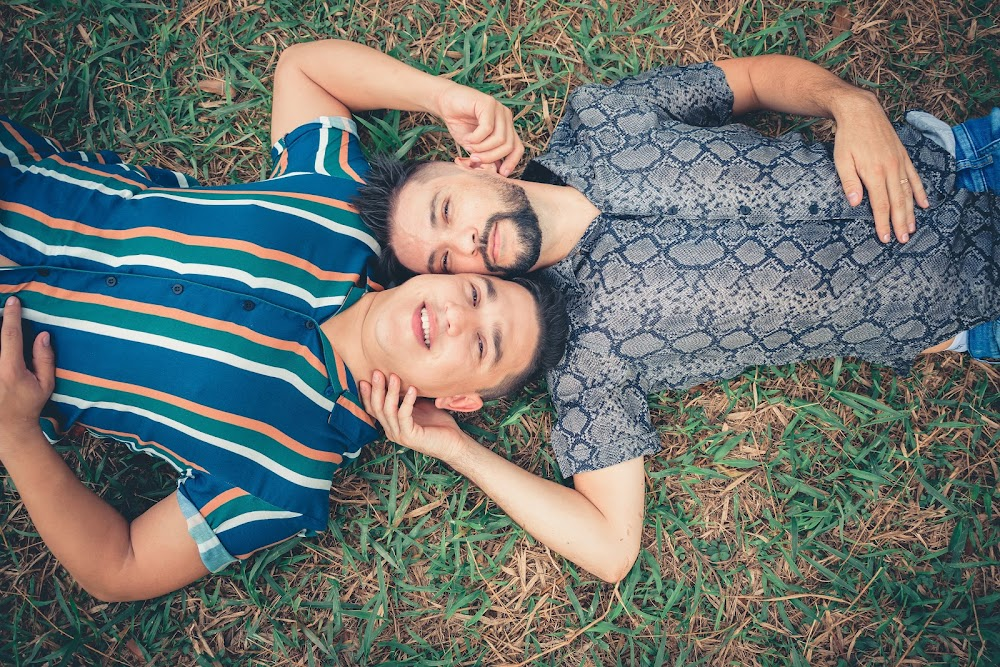 two-men-lying-on-green-grass-2440069