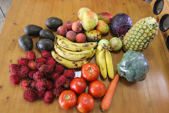 Photo: This bundle cost us $24 from the local verduleria.  Good mangos and pineapple!