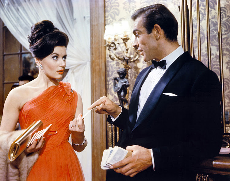 Actor Sean Connery and actress Eunice Gayson on the set of 'Dr. No'.