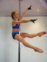 Photo: Steph Magiros - No Handed Scissor Hold - vertical pole gymnastics at Pole Fitness Studios.com.au