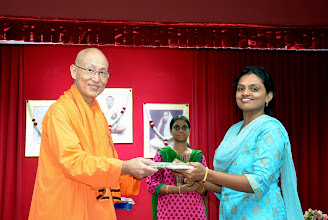 Photo: Mrs Jayashree, Volunteer receiving a token of appreciation from Swamiji