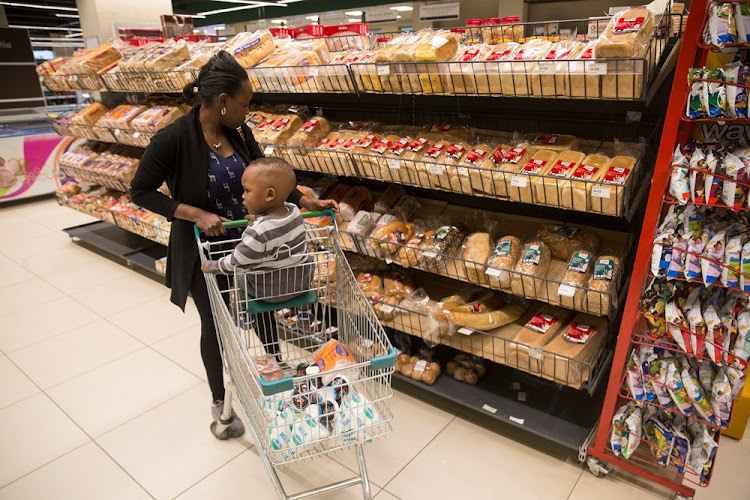 A customer stands in front of the bread section at a supermarket in Nairobi, Kenya. Uchumi Supermarkets's shake-up  saw the departure of some of the firm's top executives, including its CEO and chief financial officer. Picture: REUTERS