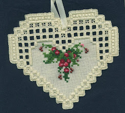 Photo: Completed 30 Sep 2007. This was my second hardanger project. It took a little while to figure out the dove's eyes as I'd forgotten from the class. But once I did they were easy. This is fast stuff!