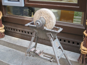 Photo: I did not have time to look up any knife grinders, but this restaurant had three nice antique wheels on display.