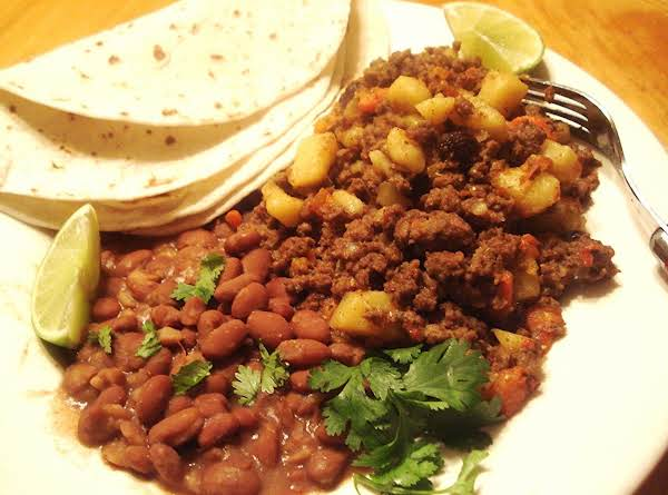 Mexican Picadillo Pictured With Tortillas And Pinto Beans.