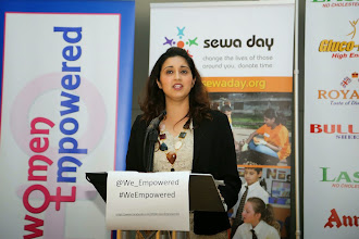 Photo: Reena Ranger welcoming guests to the event.