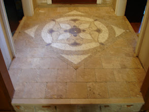 Photo: entry way medallion in the center, surrounded by 6x6 Turkish tiles  in brick pattern.