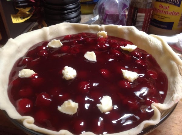 Pour both cans of cherry pie filling into a medium size bowl and add...