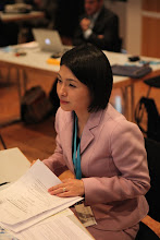 """Photo: """"Communicating Science & Innovations"""" Panel - 2012: Hiromi Yokoyama getting ready to step out"""