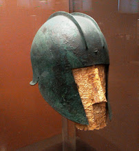 Photo: Bronze helmet, Illyrian type and gold funerary mask. Chalcidice, 530-510 BC