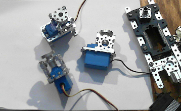 Photo: Some of the HiTec Waterproof high-voltage (7.4Volt) servos inside ServoCity Servo Blocks that I had to modify to allow them to fit the larger size of the waterproof servos. 5 of these are needed to run the controls of the Snow Blower itself.