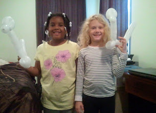 Photo: Kaleya and friend during their playdate today. Unfortunately, Kaleya's balloon animal ended up getting transformed into two...