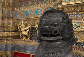"""Photo: The entrance to the Bot is guarded by """"singhas"""" - Cambodian-style stone lions. Zeiss 24mm."""