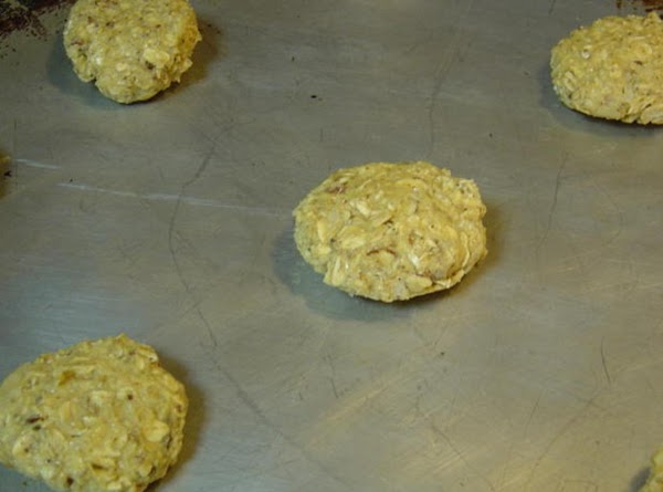 Roll dough into walnut sized balls and place 2 inches apart on an ungreased...