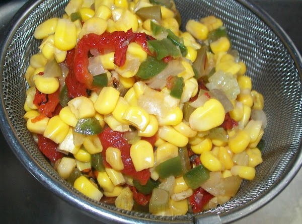 Drain the corn salsa and add the chopped green onions mix and set aside.