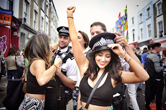 Photo: Notting Hill Carnival  - Don't pinch the bobbie's hat without asking! >> http://goo.gl/QQCVaq