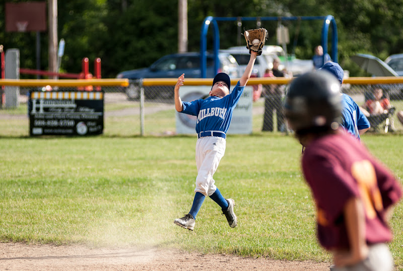 Photo: Jonathan Lahue of the Audette's Auto Body Little League team makes a leaping catch in one of the last few regular season games of 2015