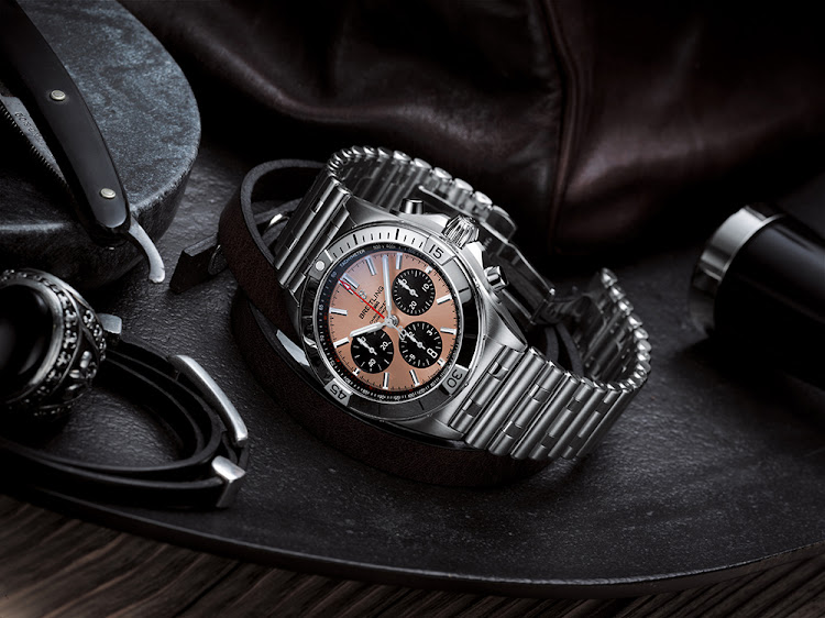 Breitling Chronomat B01 42 with salmon dial and black contrasting chronograph counters.