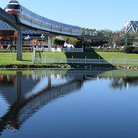 Reflecting by Keith Heinly - City,  Street & Park  Amusement Parks ( water, monorail, reflection, epcot, disney )