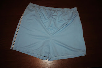 Photo: Lindsay Stevens Maternity Athletic Shorts. Mesh. Light Blue with Side Stripes. $1