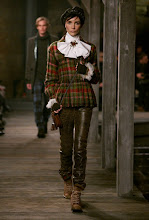 """Photo: SEE the FULL show: http://youtu.be/iTHHp75GyrY  """"The collection focused on both dark drama and Scottish classics like tartan, argyle, and kilts. But beyond that, it was Lagerfeld at his best -- with theatricality and pure fashion at every corner, from opening model Stella Tennant in a coat with a kilt and pleats to the Scottish royalty-inspired looks including the tiered white wool towards the end.""""  Photos courtesy of CHANEL"""