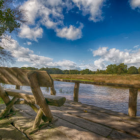 bench in october sun by Egon Zitter - Landscapes Prairies, Meadows & Fields ( stream, blue sky, bench, meadow, river )