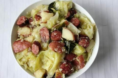 "Steamed Cabbage with Smoked Sausage & Red Potatoes ""This simple recipe will..."