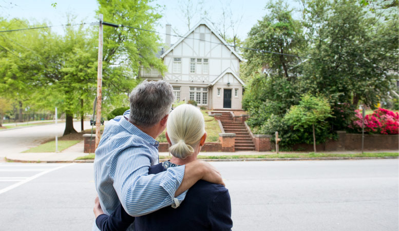 A retired couple looking at their new home
