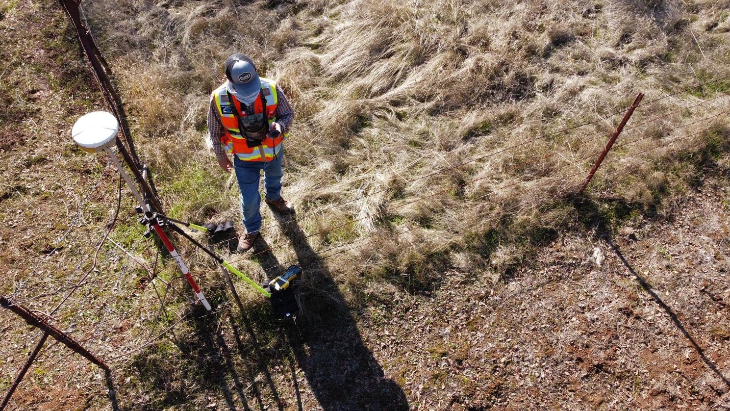 Building surveyor working on site