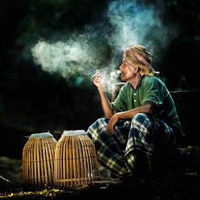 Pak Hamid by Mata Arif - People Portraits of Men ( old, smoking, street, malay, malaysia, senior citizen, men, sunlight, people, smoke, man, sun )