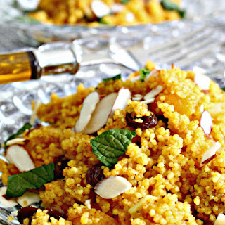 Moroccan Spiced Couscous with Orange Infusion  .