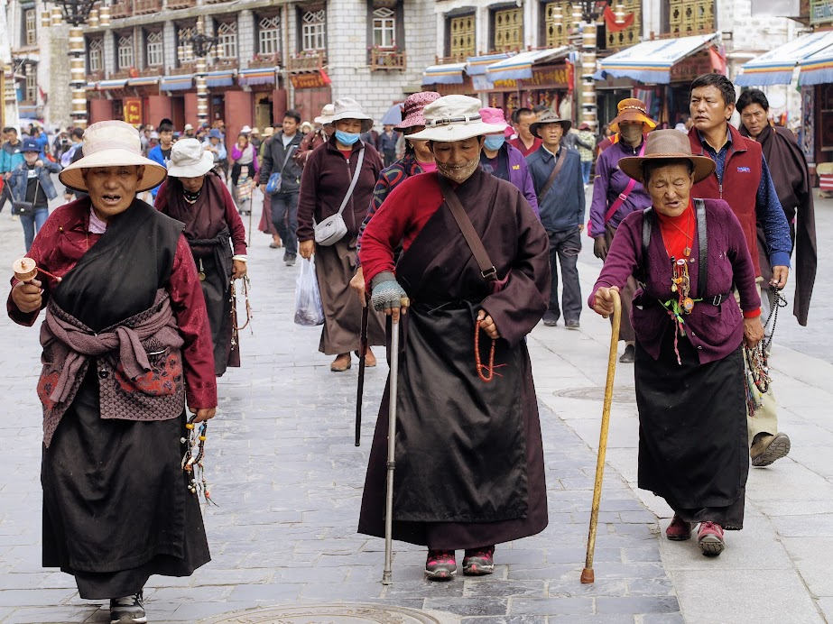 Tibetan Buddhists on their pilgrimage in Barkhor Square, Lhasa