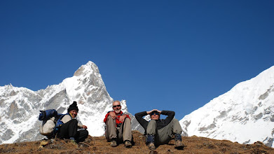 Photo: Kharta Valley, trekkers taking a scenic rest with our Tibetan (local) guide, Dorje, who was invaluable ...