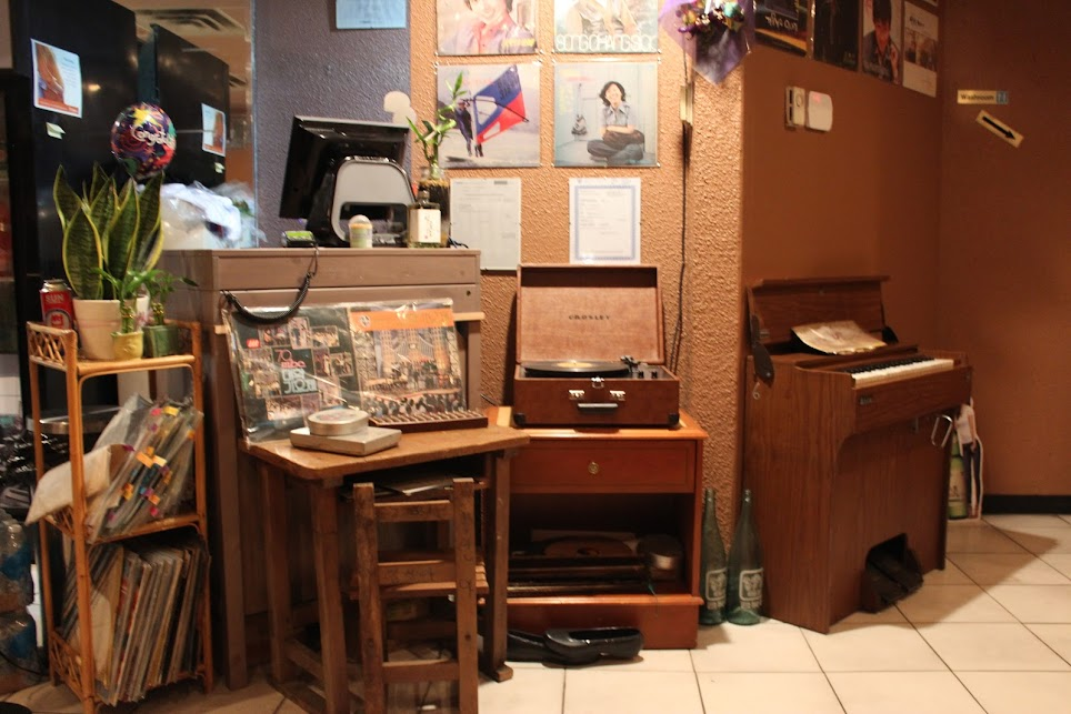 A record player and an old piano inside kookminhakgyo in toronto