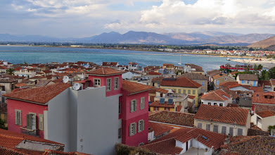 Photo: This is the view of Nafplio from our hotel. It's ridiculous. Adorable town on a hill situated on the Argolic Gulf which is that same bright teal color the whole of the Aegean seems to be.