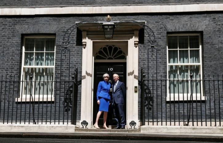 Britain's Prime Minister Theresa May and her husband pose at number 10 Downing Street. Picture: REUTERS
